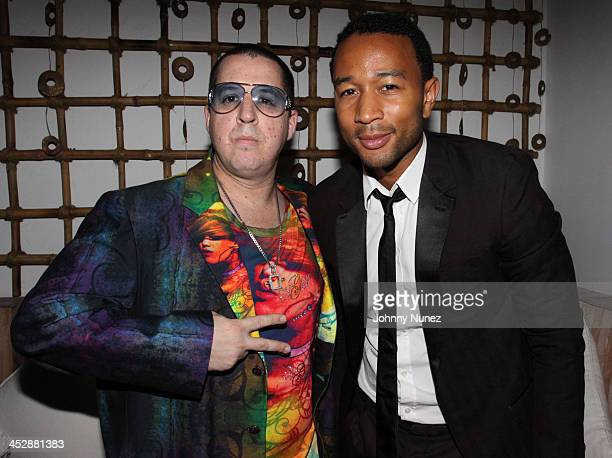Noah G Pop and John Legend attend Project Sunshine's Feel the HEAT of Fashion Art and Music at Nikki Beach on September 22 2009 in New York City