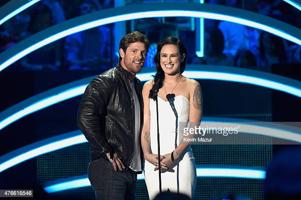 Noah Galloway and Rumer Willis speak onstage during the 2015 CMT Music awards at the Bridgestone Arena on June 10 2015 in Nashville Tennessee