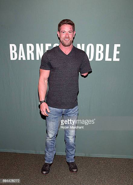 Noah Galloway signs copies of Living With No Excuses The Remarkable Rebirth Of An American Soldier at Barnes Noble Tribeca on August 23 2016 in New...
