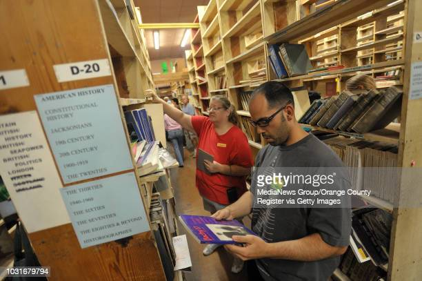 USA Noah Gonzalez searches for books during Acres of Books' last hurrah in Long Beach CA on July 10 2010 The ArtExchange who now owns the iconic Long...