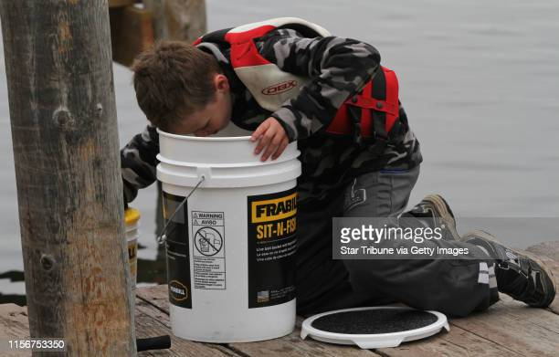 Noah Goodrich age9 from Minnetonka dug deep in the bucket to get just the right minnow as he fished off the docks at Lord Fletchers in the Minnesota...