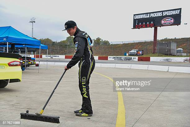 Noah Gragson driver of the AlertID/Speed Vegas/Colliers International Ford sweeps the area around his pit stall before a practice session for the...
