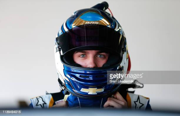 Noah Gragson driver of the ARMOUR Vienna Sausage Chevrolet stands in the garage area during practice for the NASCAR Xfinity Series MoneyLion 300 at...