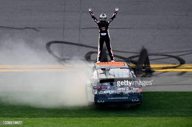 Noah Gragson driver of the Bass Pro Shops/BRCC Chevrolet celebrates after winning the NASCAR Xfinity Series NASCAR Racing Experience 300 at Daytona...