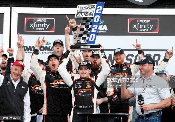 Noah Gragson driver of the Bass Pro Shops/BRCC Chevrolet celebrates with his team in Victory Lane after winning the NASCAR Xfinity Series NASCAR...