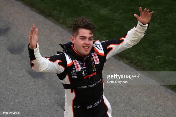 Noah Gragson driver of the Bass Pro Shops/BRCC Chevrolet celebrates winning the NASCAR Xfinity Series NASCAR Racing Experience 300 at Daytona...