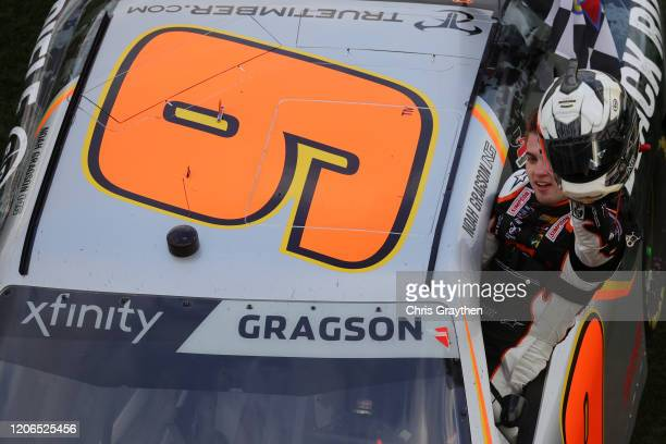 Noah Gragson driver of the Bass Pro Shops/BRCC Chevrolet celebrates with the checkered flag after winning the NASCAR Xfinity Series NASCAR Racing...