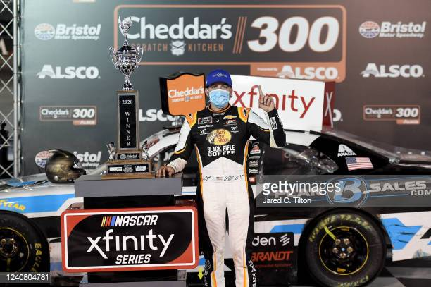 Noah Gragson driver of the Plan B Sales Chevrolet celebrates in Victory Lane after winning the NASCAR Xfinity Series Cheddar's 300 presented by Alsco...