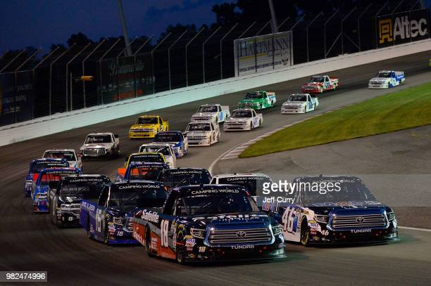 Noah Gragson driver of the Safelite Auto Glass Toyota leads a pack of trucks during the NASCAR Camping World Truck Series Villa Lighting delivers the...