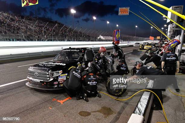 Noah Gragson driver of the Safelite Auto Glass Toyota pits during the NASCAR Camping World Truck Series Villa Lighting delivers the Eaton 200 at...
