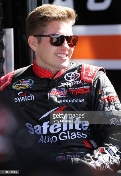 Noah Gragson driver of the Safelite Autoglass Toyota stands by his truck during practice for the NASCAR Camping World Truck Series NextEra Energy...