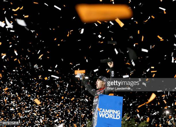 Noah Gragson driver of the Safelite Toyota celebrates in victory lane after winning the NASCAR Camping World Truck Series 37 Kind Days 250 at Kansas...