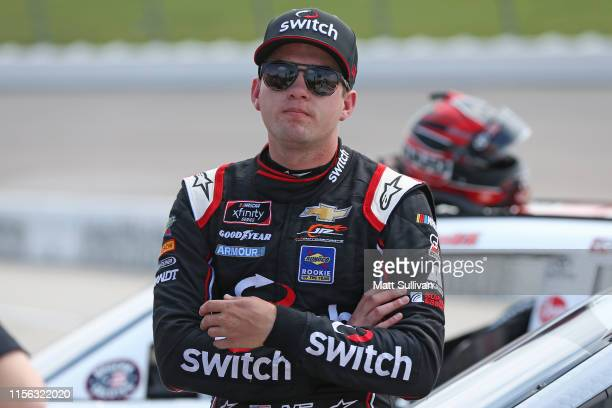 Noah Gragson driver of the Switch Chevrolet watches qualifying for the NASCAR Xfinity Series CircuitCitycom 250 Presented by Tamron at Iowa Speedway...