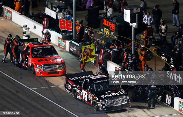 Noah Gragson driver of the Switch Toyota and Grant Enfinger driver of the Ride TV Toyota pit during the NASCAR Camping World Truck Series JAG Metals...