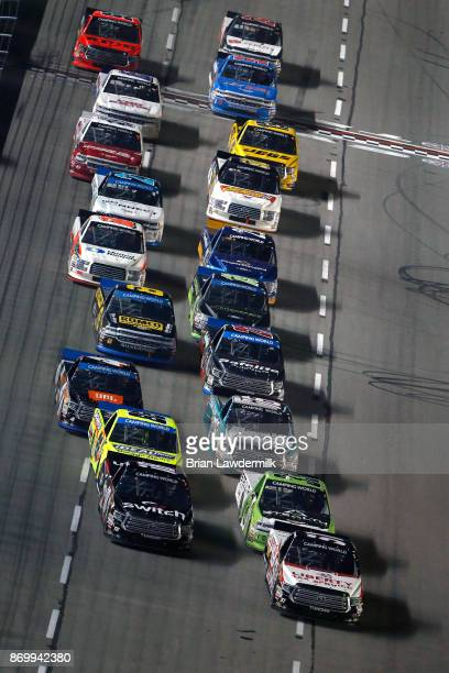 Noah Gragson driver of the Switch Toyota and Myatt Snider driver of the Liberty Tax Service Toyota lead the field during the NASCAR Camping World...