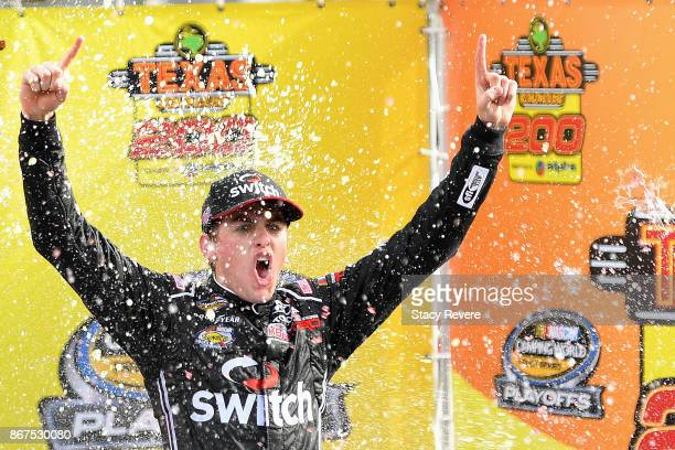 Noah Gragson driver of the Switch Toyota celebrates in Victory Lane after winning the NASCAR Camping World Truck Series Texas Roadhouse 200 at...