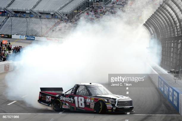 Noah Gragson driver of the Switch Toyota celebrates with a burnout after winning the NASCAR Camping World Truck Series Texas Roadhouse 200 at...