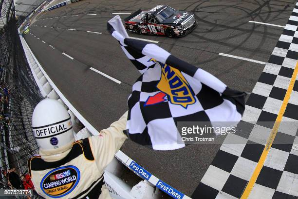 Noah Gragson driver of the Switch Toyota takes the checkered flag to win the NASCAR Camping World Truck Series Texas Roadhouse 200 at Martinsville...