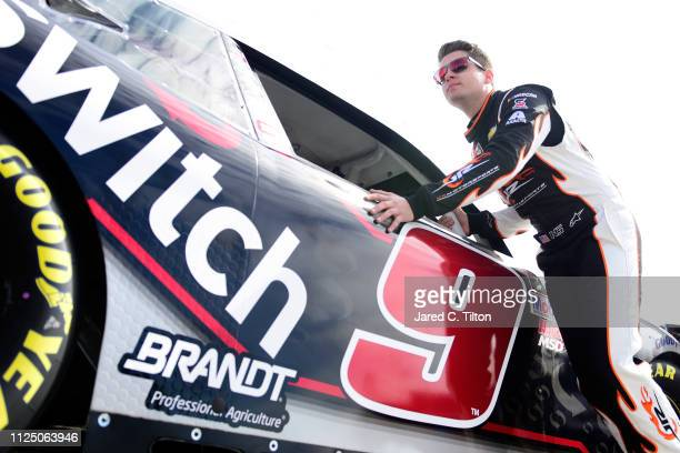 Noah Gragson pushes the Switch Chevrolet through the garage area during practice for the NASCAR Xfinity Series NASCAR Racing Experience 300 at...