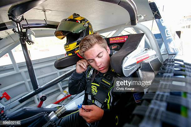 Noah Grayson driver of the SPEEDVEGAS/AlertID/Colliers Intâl Ford is seen during a practice for the NASCAR KN Pro Series East Kevin Whitaker...