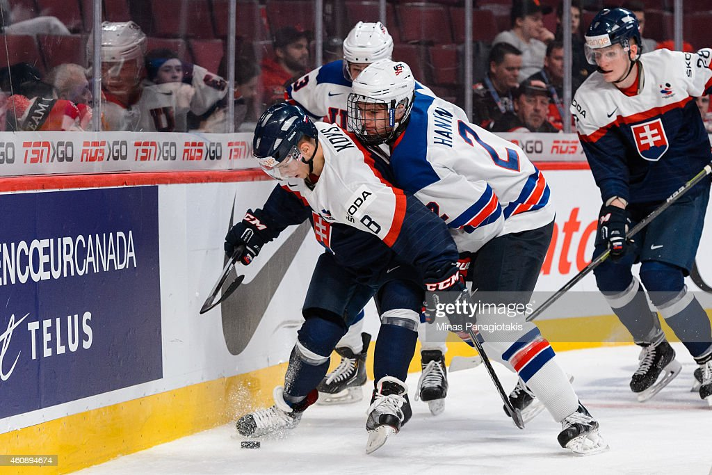 Noah Hanifin #2 of Team United States challenges Patrik Koys #8 of Team Slovakia behind the net during the 2015 IIHF World Junior Hockey Championship game at the Bell Centre on December 29, 2014 in Montreal, Quebec, Canada.