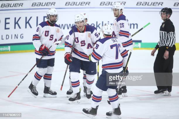Noah Hanifin of USA celebrates his team's second goal with team mates during the international friendly game between Germany and USA ahead of the...