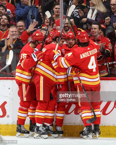 Noah Hanifin, Sean Monahan, Elias Lindholm, and Rasmus Andersson of the Calgary Flames celebrate after Johnny Gaudreau of the Calgary Flames scored a...