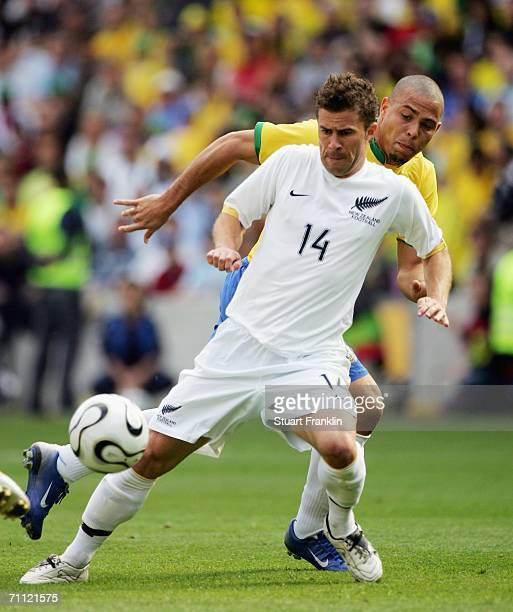 Noah Hickey of New Zealand is challenged by Ronaldo of Brazil during the international friendly match between Brazil and New Zealand at the Stadium...