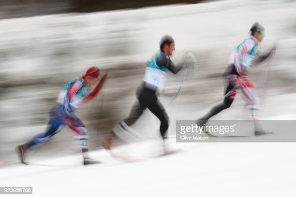 Noah Hoffman of the United States Thomas Bing of Germany and Max Hauke of Austria compete during the Men's 50km Mass Start Classic on day 15 of the...