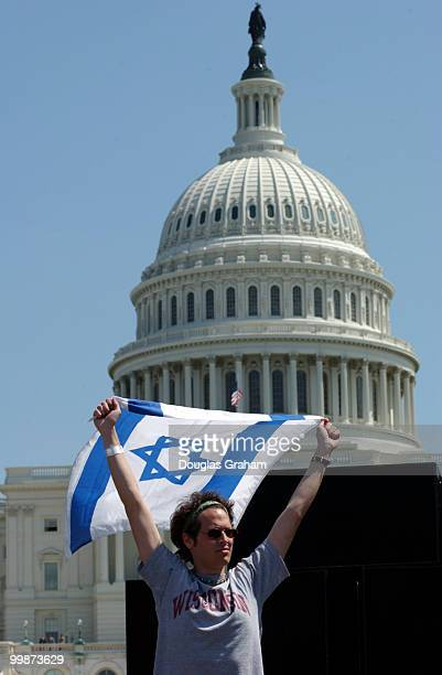 Noah Jubelirer of Wisconsin, waves an Israeli flag during the pro Israel protest on the West Front of the U.S. Capitol.
