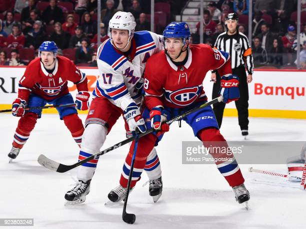 Noah Juulsen of the Montreal Canadiens defends in his first ever NHL game against Jesper Fast of the New York Rangers at the Bell Centre on February...