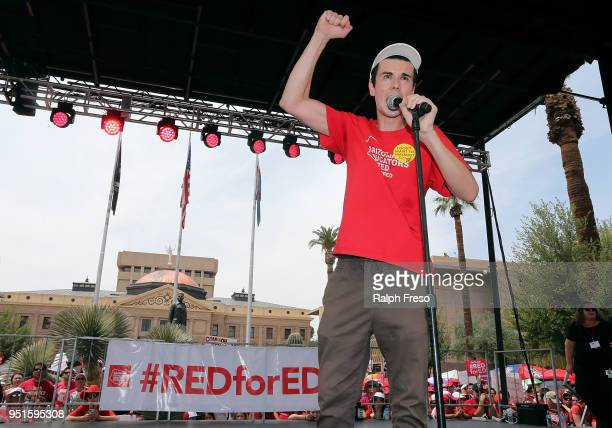 Noah Karvelis an organizer of the #REDforED movement speaks during a rally in front of the State Capitol on April 26 2018 in Phoenix Arizona Teachers...