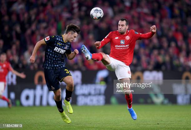 Noah Katterbach of 1.FC Koln is challenged by Levin Öztunali of 1.FSV Mainz 05 during the Bundesliga match between 1. FSV Mainz 05 and 1. FC Koeln at...