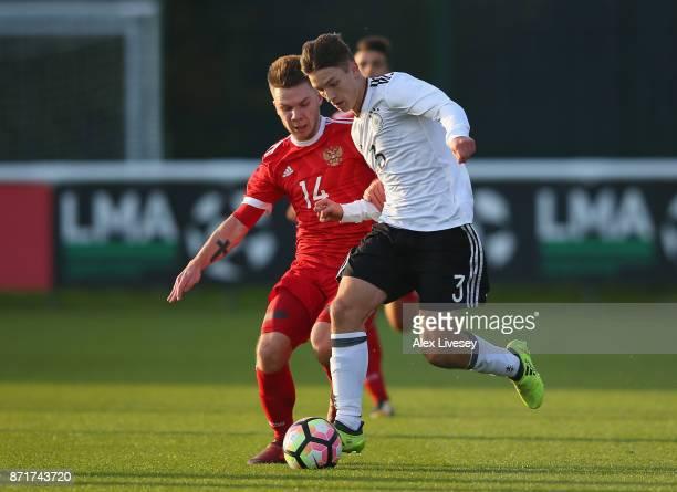 Noah Katterbach of Germany U17 beats Nikita Sharkov of Russia U17 during the International match between Russia U17 and Germany U17 at St Georges...