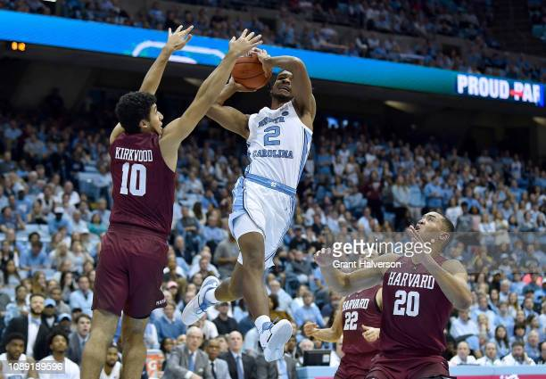 Noah Kirkwood of the Harvard Crimson fouls Coby White of the North Carolina Tar Heels during the second half at the Dean Smith Center on January 02...