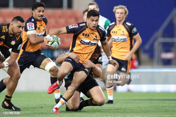 Noah Lolesio of the Brumbies is tackled during the round four Super Rugby match between the Chiefs and the Brumbies at FMG Stadium on February 22,...