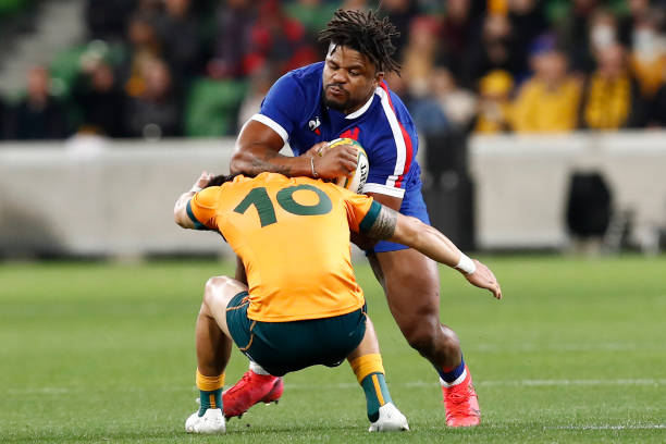 MELBOURNE, AUSTRALIA - JULY 13: Noah Lolesio of the Wallabies tackles Jonathan Danty of France during the International Test match between the Australian Wallabies and France at AAMI Park on July 13, 2021 in Melbourne, Australia. (Photo by Darrian Traynor/Getty Images)
