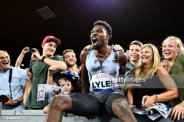 Noah Lyles celebrates with supporters after winning the Men 100m during the IAAF Diamond League competition on August 29 in Zurich.
