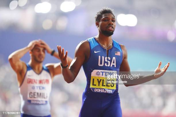 Noah Lyles of the United States celebrates winning the Men's 200 Metres final as Adam Gemili of Great Britain looks on during day five of 17th IAAF...