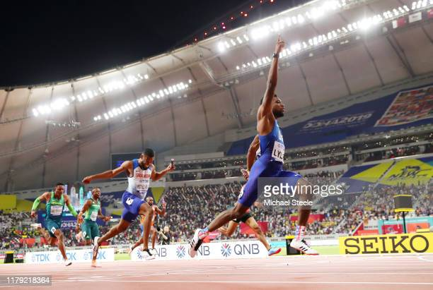 Noah Lyles of the United States, gold, and Nethaneel Mitchell-Blake of Great Britain, silver, compete in the Men's 4x100 Metres Relay during day nine...