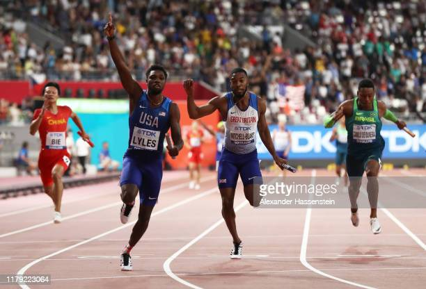 Noah Lyles of the United States gold and Nethaneel MitchellBlake of Great Britain silver compete in the Men's 4x100 Metres Relay during day nine of...