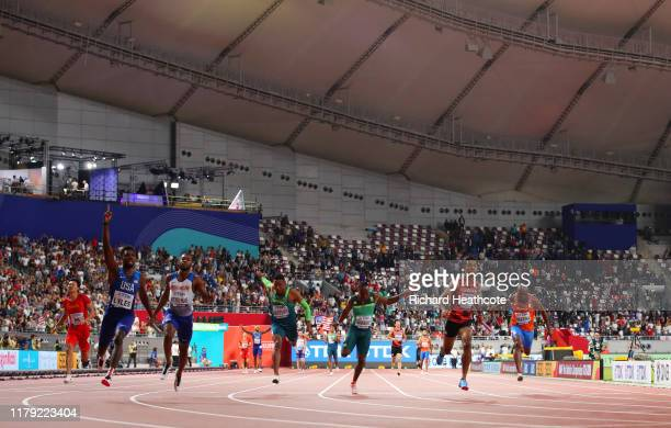 Noah Lyles of the United States, gold, and Nethaneel Mitchell-Blake of Great Britain, silver, and Abdul Hakim Sani Brown of Japan, bronze, compete in...
