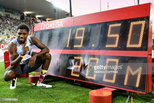 Noah Lyles of the US poses next to a screen reading his time for the Men's 200m as he celebrates after breaking the meeting record in the discipline...