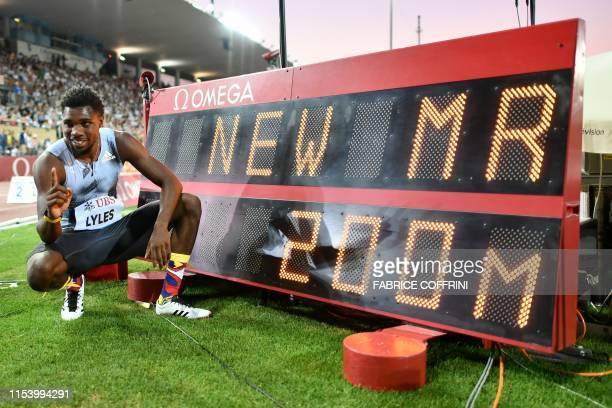 Noah Lyles of the US poses next to a screen reading new meeting record for the men's 200m as he celebrates after winning in the Men's 200m during the...