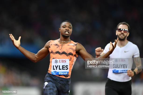 Noah Lyles of the US wins ahead of secondplacedTurkey's Ramil Guliyev in the men's 200 metres race during the IAAF Diamond League 'Weltklasse'...