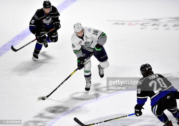 Noah Philp of the Seattle Thunderbirds is sandwiched between two Victoria Royals defenders in the first period at the accesso ShoWare Center on March...
