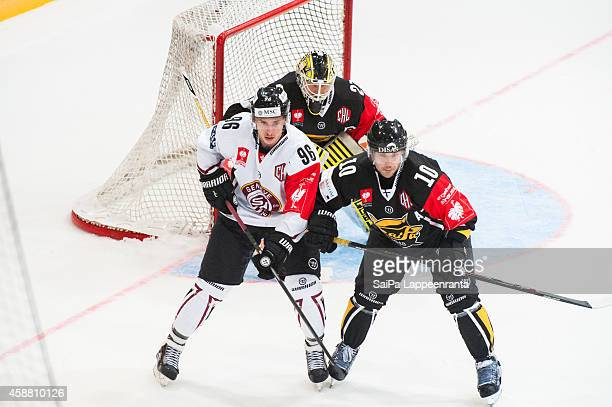 Noah Rod of Geneve Servette and Ville Hamalainen during the Champions Hockey League round of 16 second leg game between SaiPa Lappeenranta and...
