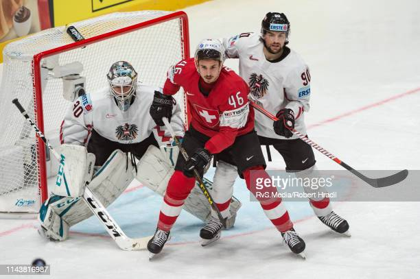 Noah Rod vies with Alexander Pallestrang during the 2019 IIHF Ice Hockey World Championship Slovakia group game between Switzerland and Austria at...