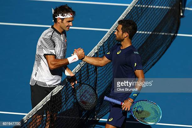 Noah Rubin of the United States congratulates Roger Federer of Switzerland after their second round match on day three of the 2017 Australian Open at...