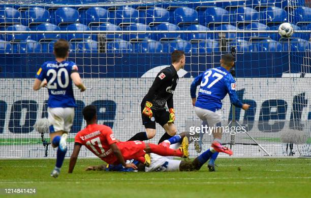 Noah Saranren Bazee of Augsburg scores his team's second goal during the Bundesliga match between FC Schalke 04 and FC Augsburg at VeltinsArena on...